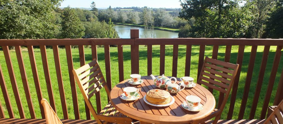 View over Blagdon Farm Fishing Lake from a lodge veranda